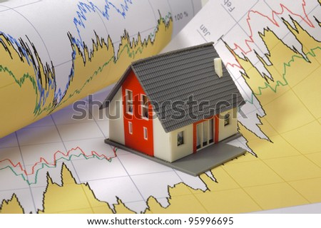 model house on financial business chart - stock photo