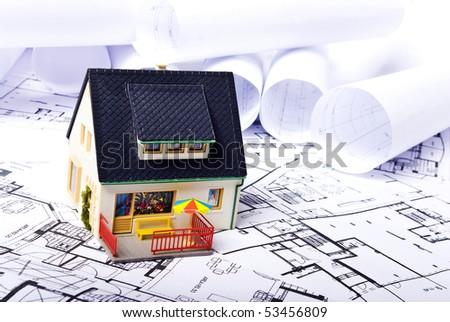 model house on plans background - stock photo