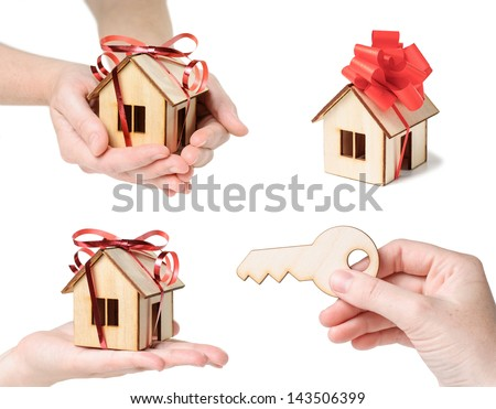 Model house set with hands, ribbon and key  - isolated on white background.