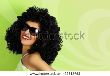 Model in a big afro wig. disco. dancer - stock photo
