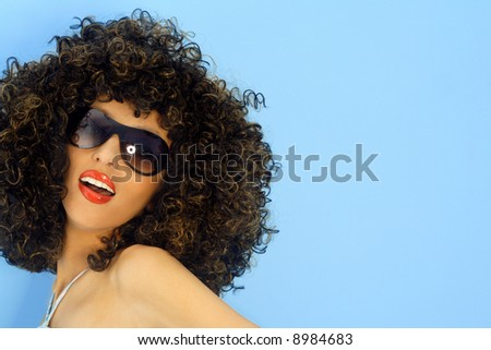 Model in a big afro wig. disco dancer - stock photo