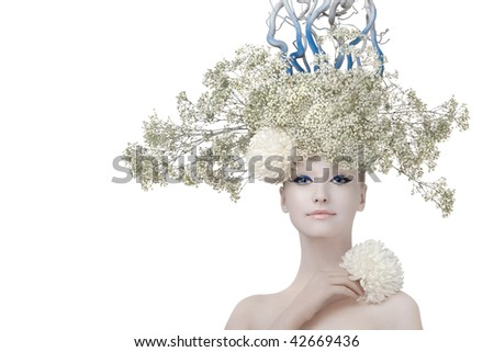 Model in an image of the winter, created by means of a make-up, Body- Art and floristics art on a white background. - stock photo