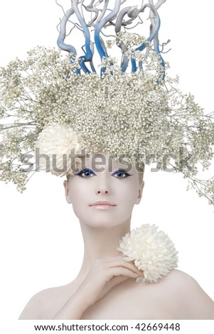 Model in an image of the winter, created by means of a make-up, Body-Art and floristics art on a white background. - stock photo