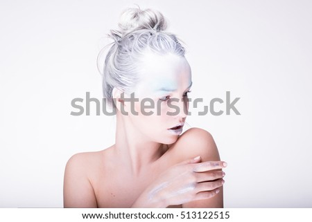 Model in creative image with silver blue artistic make-up