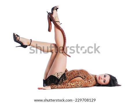 Model in dress with snake - stock photo