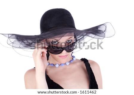 model in elegant hat and sunglasses - stock photo