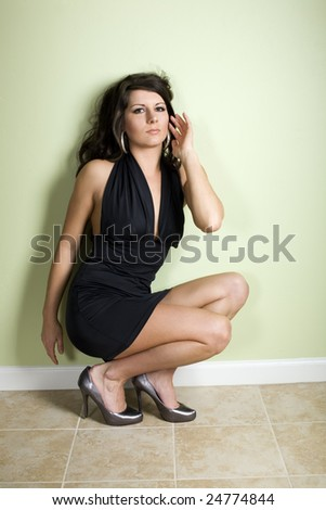 Model in little dress looking at you