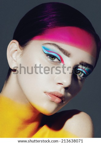 model in studio with bright make up  - stock photo