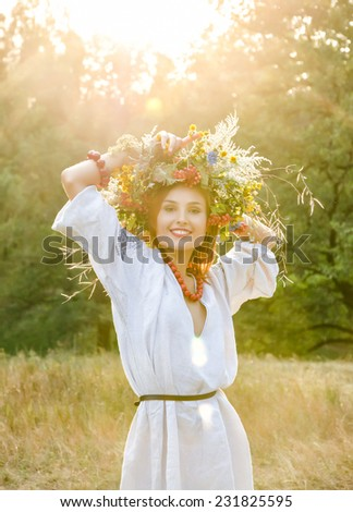 Model in wreath from flower - stock photo
