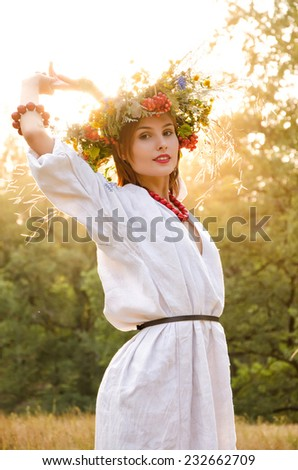 Model in wreath from flower - stock photo