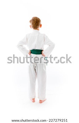 model isolated on plain background back hands on hips - stock photo