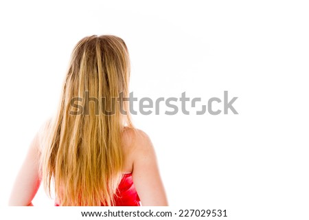 model isolated on plain background back looking behind - stock photo