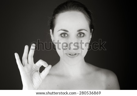 model isolated on plain background hand gesture ok sign - stock photo