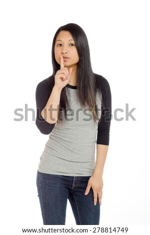 Model isolated on plain background in studio fingers on lips with secret - stock photo