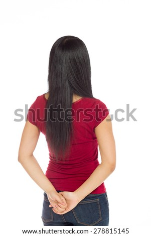Model isolated on plain background in studio from behind