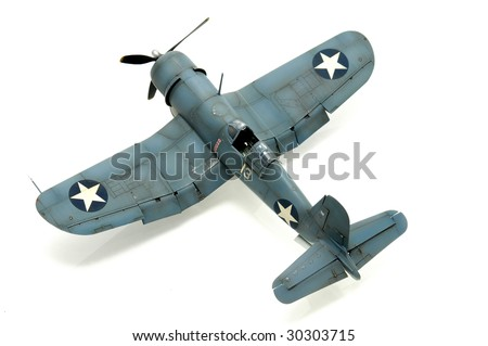 Model kit of an WWII american fighter isolated in white - stock photo