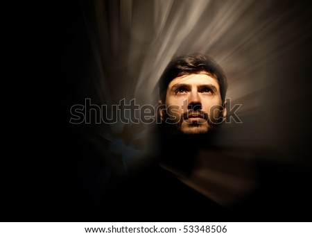 Model looking up towards the light - stock photo