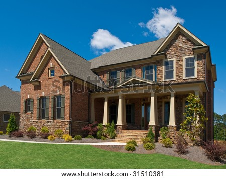 Model Luxury Home Exterior side view with columns - stock photo