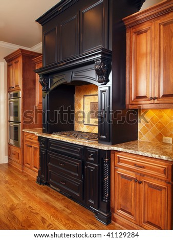 Model Luxury Home Interior Kitchen with mixed tone cabinets - stock photo