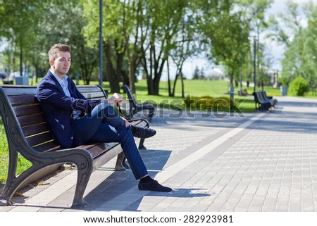 model, man, business style in the park, jacket, trousers, bright, summer, sun, day
