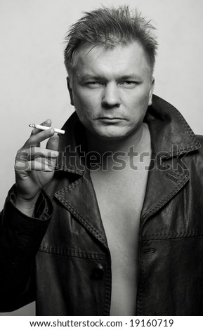 model man in black leather jacket on gray background
