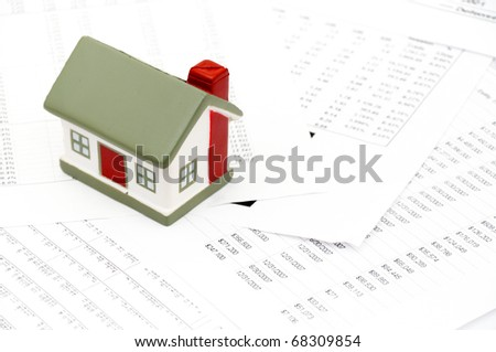 Model of a house lying on some chart