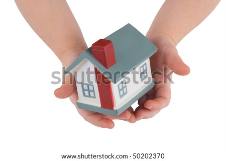 Model of a house on child's hands isolated on white - stock photo