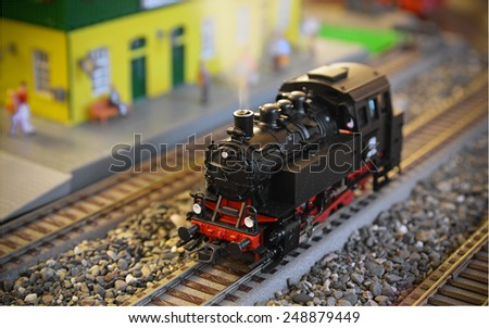 Model of a steam locomotive with smoke - stock photo