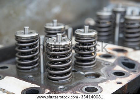 model of a vehicle engine, engine exhaust valve and intake valve, spring valve of the engine and auto spare parts, machine parts damaged from work.