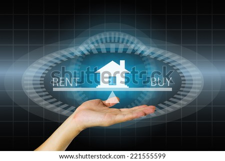 Model of home in hand on modern dark background. - stock photo