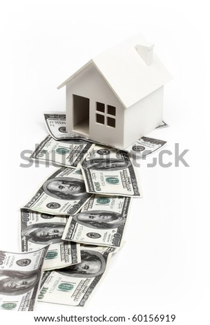 Model of house on the path of money. Real estate concept - stock photo