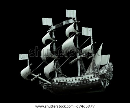 Model of old military ship on black background