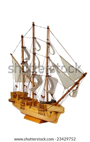 Model of ship with sails on a white background - stock photo