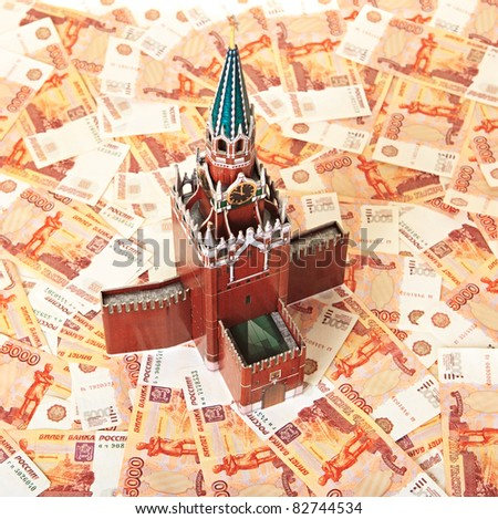 Model of the Moscow Kremlin in the background of five thousandth notes (Moscow stands for big money)
