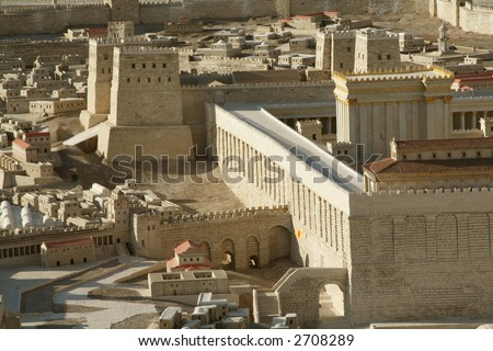 Model of the 2nd temple in Jerusalem with an arrow highlighting the western wall - stock photo
