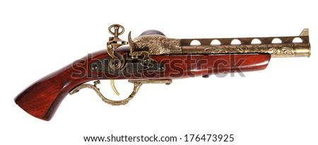 Model of the old gun on the white background, souvenir - stock photo
