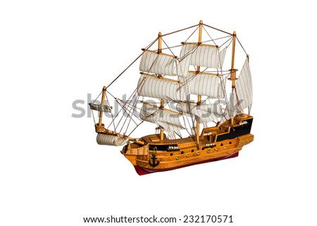 Model of the old sailing merchant ships with cannons and masts isolated on white background - stock photo