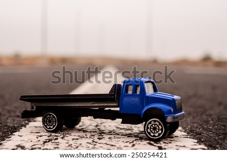 Model of the Truck on an Asphalt Road - stock photo