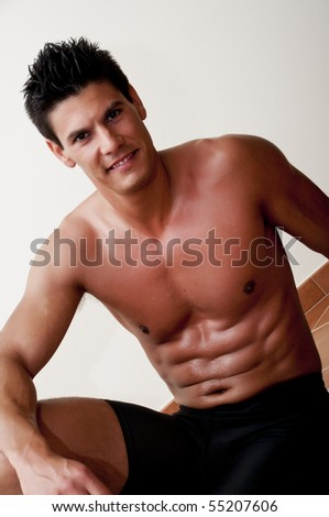 model photographed in the studio, doing sports - stock photo