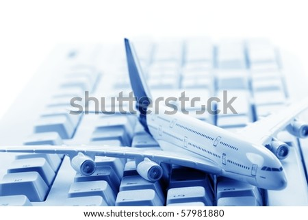 Model plane on computer keyboard,Closeup and shallow Dof. - stock photo