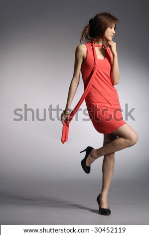 model posed on light background in nice dress - stock photo