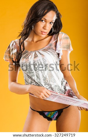 Model poses wearing short dress - stock photo