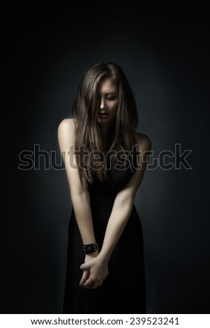 model posing between shadow and light - stock photo