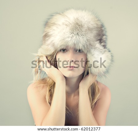 Model posing in winter clothes - stock photo