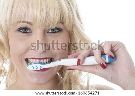 Model Released. Attractive Young Woman Brushing Teeth