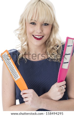 Model Released. Attractive Young Woman Holding Kitchen Utensils
