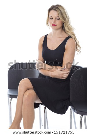 Model Released. Attractive Young Woman Sitting Waiting
