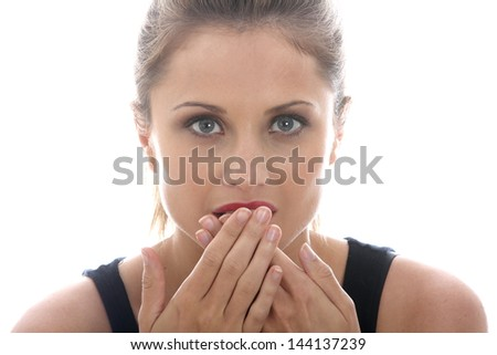 Model Released. Embarrassed Young Woman Covering Mouth