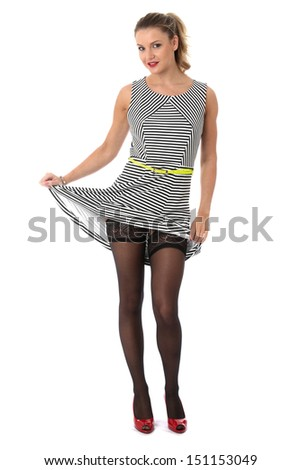 Model Released. Sexy Young Woman Raising Skirt Showing Stocking Tops