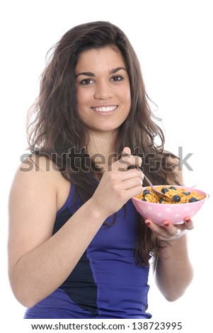Model Released. Young Woman Eating Breakfast Cereal